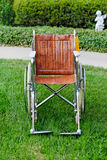 Wheelchair. Old Wheelchair outside on grass royalty free stock photo