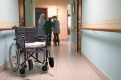 Wheelchair. Wheelchair in a corridor of the house for older persons Stock Photo