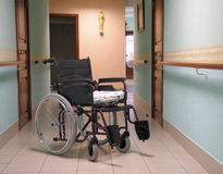 Wheelchair. Wheelchair in a corridor of the house for older persons Royalty Free Stock Photo