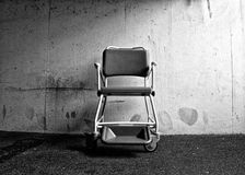 Wheelchair. Abandoned wheelchair in an underground carpark Stock Photo