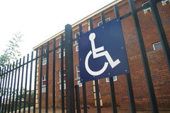 Wheelchair access. Sign at a parking space reserved for dissabled drivers royalty free stock photography