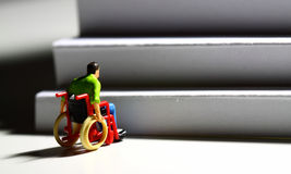 Wheelchair access stairs man figure E Royalty Free Stock Image