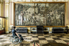 Wheelchair Admires The Works Of Art At The State Hermitage Museum In St. Petersburg Stock Image