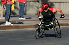 Wheelchair Athlete in Marathon Stock Images
