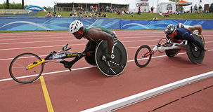 Wheelchair athletes race canada. 10,000-meter run wheelchair athletes Jean-Paul Compaore and Michel Filteau compete at the Canadian Track & Field Championships royalty free stock photo