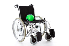 Wheelchair with ball Stock Photography