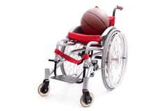 Wheelchair and basketball Royalty Free Stock Photography