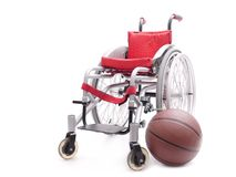 Wheelchair and basketball Stock Photo