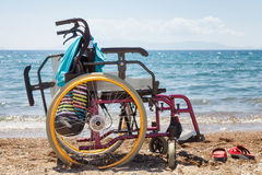 Wheelchair on the beach Stock Photo