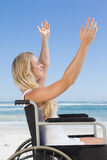 Wheelchair bound blonde smiling on the beach Stock Photography