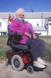 Wheelchair bound elderly woman Stock Image