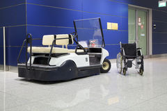 Wheelchair and buggy in airport Stock Photos