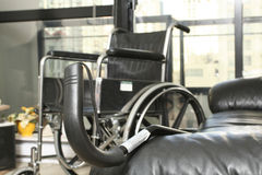 Wheelchair and cane Royalty Free Stock Photography