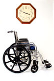 Wheelchair and Clock Stock Photography