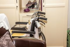Wheelchair close to chair in a retirement home.  Royalty Free Stock Images