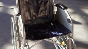 Wheelchair close up.Steady shot. Empty wheelchair close-up .Sun.Concept idea stock video