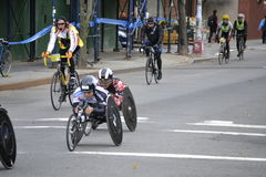 Wheelchair Competitors and Bike Guides NYC Marathon Stock Image