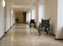 Wheelchair in corridor of hospital Royalty Free Stock Photos