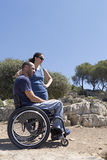 Wheelchair Couple Gaze. A couple, men in a wheelchair, Looking out at the View Stock Image
