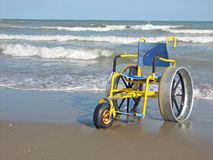 Wheelchair designed for use on the Sea Beach Stock Photos