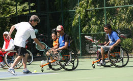 Wheelchair. Disabled athletes get coaching clinic sport wheelchair tennis in Solo, Central Java, Indonesia Royalty Free Stock Image