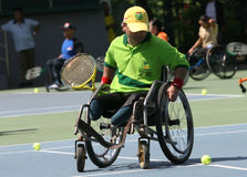 Wheelchair. Disabled athletes get coaching clinic sport wheelchair tennis in Solo, Central Java, Indonesia Stock Image