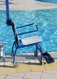 Wheelchair for disabled people at the swimming pool Royalty Free Stock Image