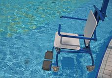 Wheelchair for the disabled for swimming pool 2 Stock Photography