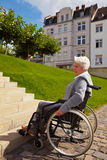 Wheelchair driver having problem Stock Images
