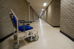 Wheelchair in an empty NHS hospital corridor royalty free stock photos