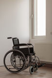Wheelchair in empty room royalty free stock photo