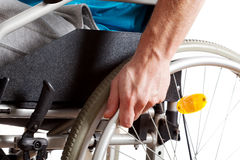 Wheelchair and hand closeup Stock Photography