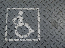 Wheelchair handicap sign lane on grey metal background. Wheelchair handicap sign lane on old grey metal background Stock Photography