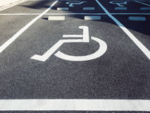 Wheelchair Handicap Sign at Parking lot. Outdoor Stock Image