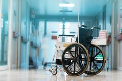 Wheelchair in hospital. Health, care, patient, medical, clinic, nurse, doctor, disabled, illness, help, medicine, female, disability, corridor, elderly royalty free stock photos