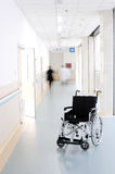 Wheelchair in hospital corridor Royalty Free Stock Photos