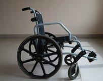 Wheelchair in the hospital near the window stock photos