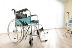 Wheelchair in the hospital room, concept for the health care of royalty free stock photo