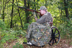 Wheelchair hunter with shotgun Royalty Free Stock Images