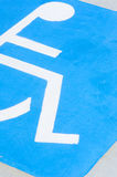 Wheelchair icon on disabled car park floor Royalty Free Stock Images