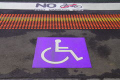 Wheelchair with information sign on floor background for disabled people Royalty Free Stock Image