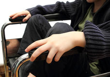 Wheelchair kid Stock Images