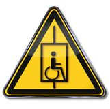 Wheelchair in a lift Royalty Free Stock Photo