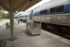 Wheelchair lift and passenger train Stock Image