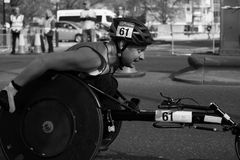 Wheelchair Marathon Racer. Determined Wheelchair Marathon Racer Looking Ahead Royalty Free Stock Photo