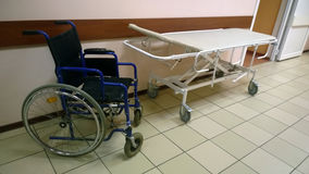 Wheelchair and medical bed Royalty Free Stock Photos