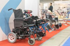 Wheelchair at a medical exhibition. Wheelchair with electric motor stock image