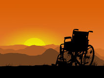 Wheelchair in mountains Stock Image