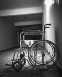 Wheelchair in the old hospital Stock Photos
