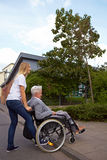 With wheelchair over a curbstone Stock Images